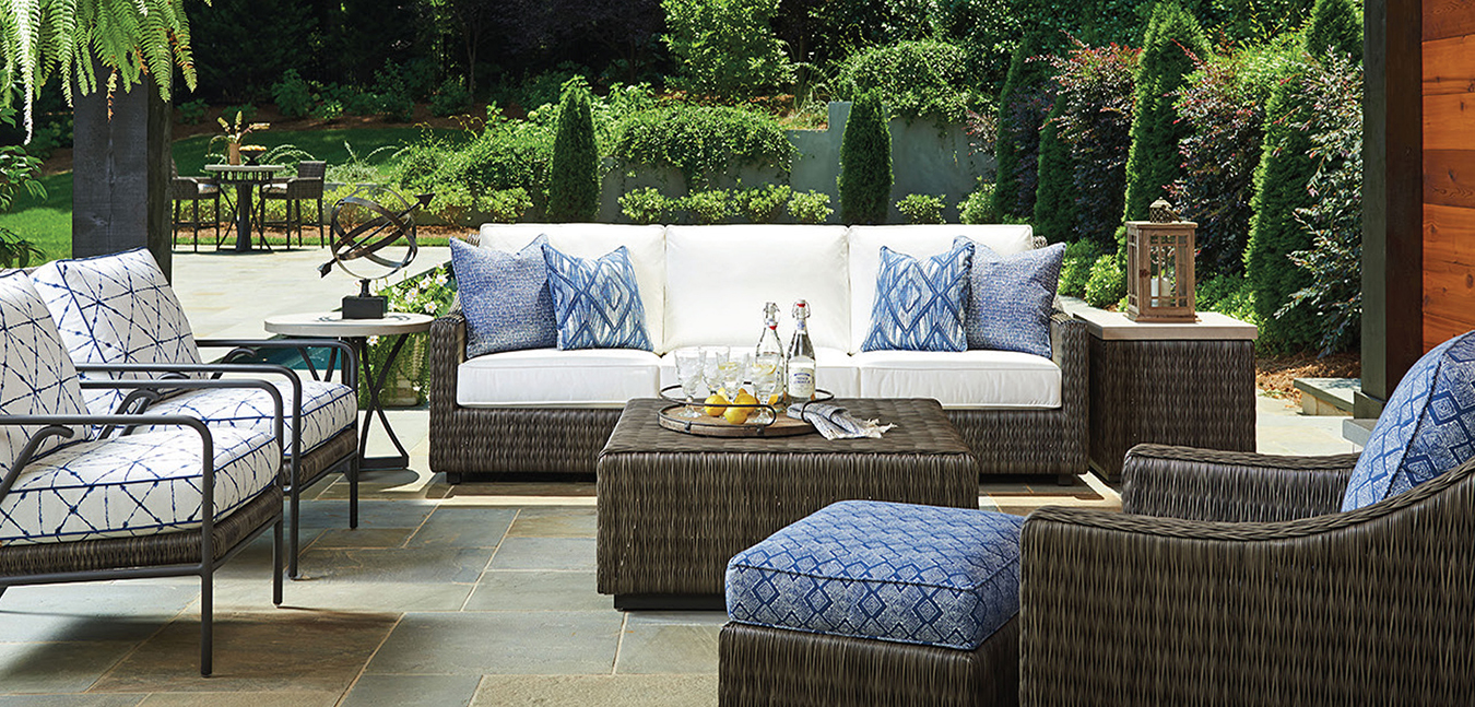 Cypress Point Ocean Terrace features a distinctive V-pattern of all-weather woven wicker, aluminum frames in a custom aged iron finish and contemporary Weatherstone tops that emulate honed limestone.